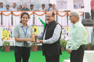 College Vice-Captain, Aanchal Saxena receiving her award from the Director.