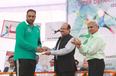 Sports Officer receiving award from the Director.